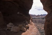 022:  A view through a rock keyhole, looking up canyon at where we have just traveled from.